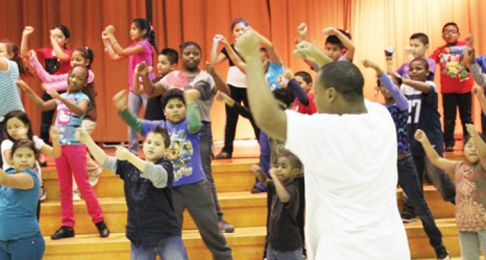 Teacher's assistant keeps students on their toes with dance group