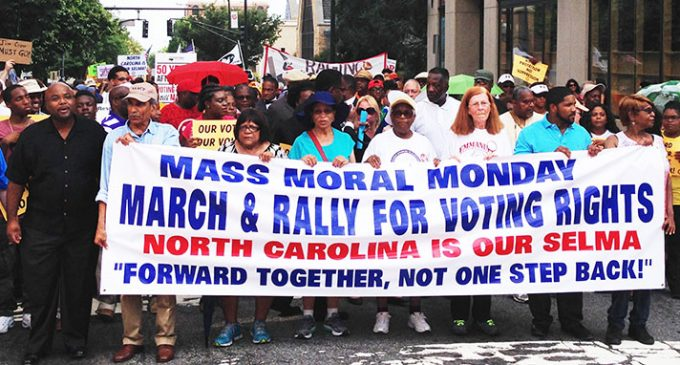 March and rally draw thousands on first day of historic voting rights trial