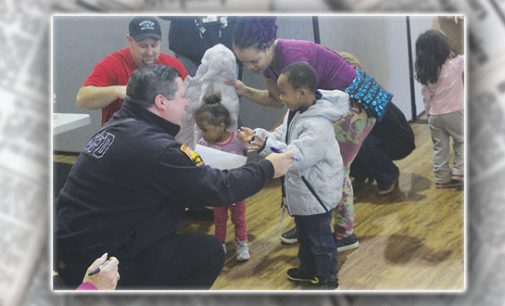 Local firefighters, Family Services give winter coats to preschoolers