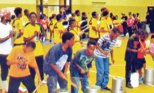 Back-to-school cookout at rec center attracts adults and kids