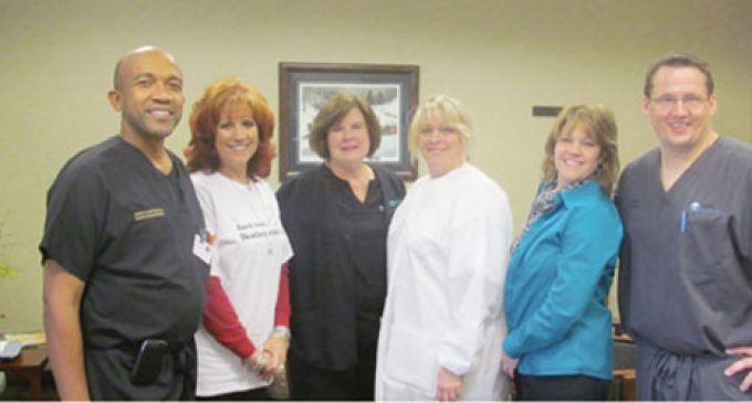 Volunteers provide thousands in free dental services
