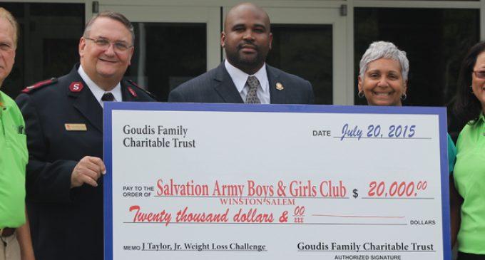 Councilman James Taylor presents check to Boys and Girls Club