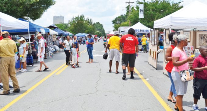 Juneteenth festival-goers mark black freedom amid mourning for slain church members