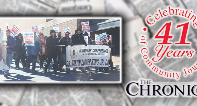 Dozens march in the cold to honor Dr. King