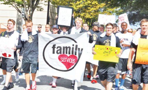 Men Take Symbolic Walk Against Abuse