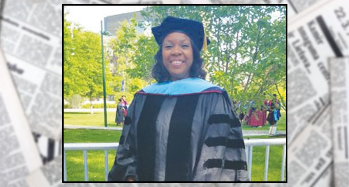 Triad publisher receives doctorate