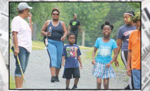 Church holds prayer walk to raise funds to help children