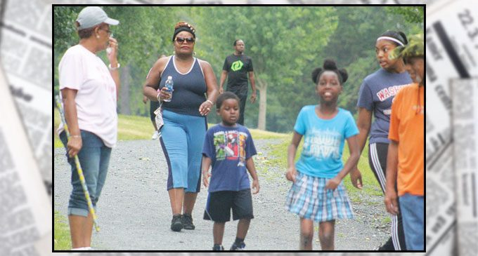Church holds prayer walk to raise funds to help children