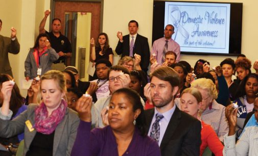 Vigil shines light on domestic violence