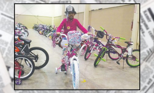 More than 300 children trade violent toys for good toys