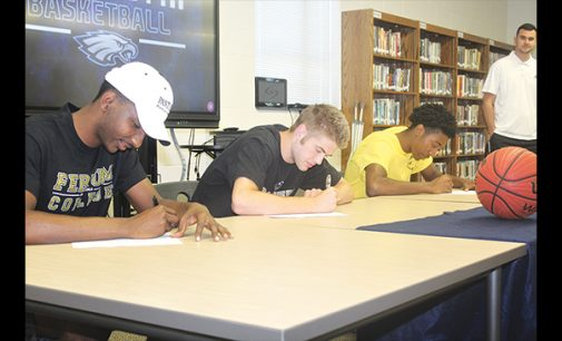Three Eagles sign to play college basketball