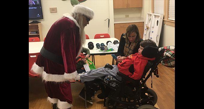 Santa visits children at Little Red Schoolhouse