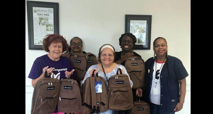 Quality Independent Living delivers book bags for the homeless