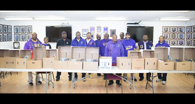 Local fraternity provides Thanksgiving boxes for the needy