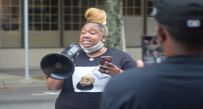Widow of Julius Sampson speaks during Stand Your Ground law protest