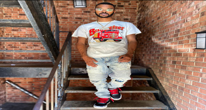 Local artist signs record label deal