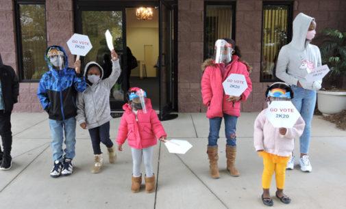 Children model proper mask-wearing behavior