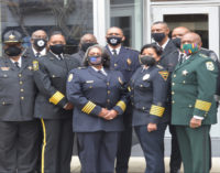 Black law enforcement officers  commemorate the historic Greensboro sit-in
