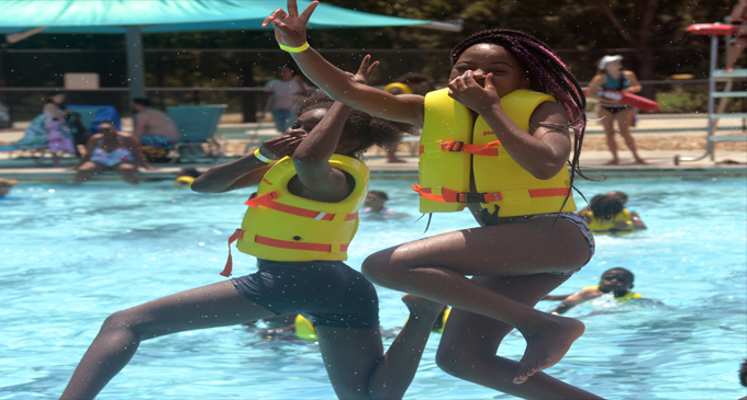 Marva Reid treats local children to a day at the water park
