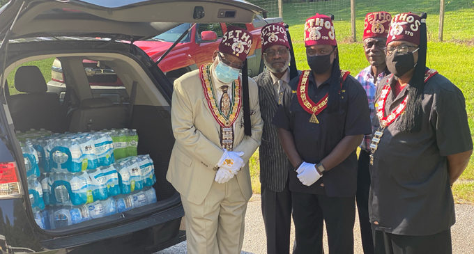 Shriners donate bottles of water to local homeless shelter